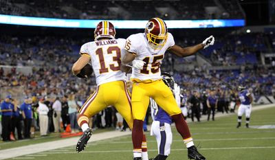 Washington Redskins wide receivers Nick Williams, left, and Aldrick Robinson celebrate Williams' touchdown in the second half of an NFL preseason football game against the Baltimore Ravens, Saturday, Aug. 23, 2014, in Baltimore. (AP Photo/Nick Wass)