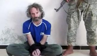 In this image made from undated video obtained by The Associated Press, which has been authenticated based on its contents and other AP reporting, a man believed to be Peter Theo Curtis, a U.S. citizen held hostage by an al-Qaida linked group in Syria, delivers a statement. The U.S. government said on Sunday, Aug. 24, 2014 that Curtis, who had been held hostage for about two years, had been released. (AP Photo)