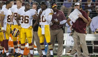 Washington Redskins' quarterback Robert Griffin III (left) and head coach Jay Gruden (right) on the sidelines during the third quarter against the Baltimore Ravens during their pre-season game at M&T Bank Stadium on August 23, 2014 in Baltimore, Maryland. Baltimore won the game 23-17. (Pete Marovich Special to The Washington Times)
