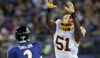 Washington Redskins' linebacker Everette Brown defends against a Baltimore Ravens' Tyrod Taylor pass during the first quarter of their pre-season game at M&T Bank Stadium on August 23, 2014 in Baltimore, Maryland. Baltimore won the game 23-17. (Pete Marovich Special to The Washington Times)