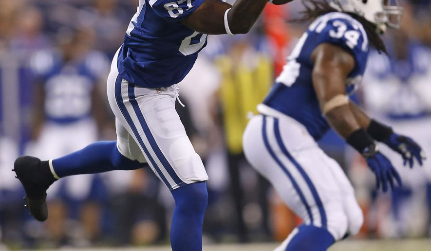 Indianapolis Colts wide receiver Reggie Wayne makes a catch against the New Orleans Saints during the first half of an NFL preseason football game in Indianapolis, Saturday, Aug. 23, 2014. Wayne caught two passes, but both were wiped out by penalties. (AP Photo/Sam Riche)