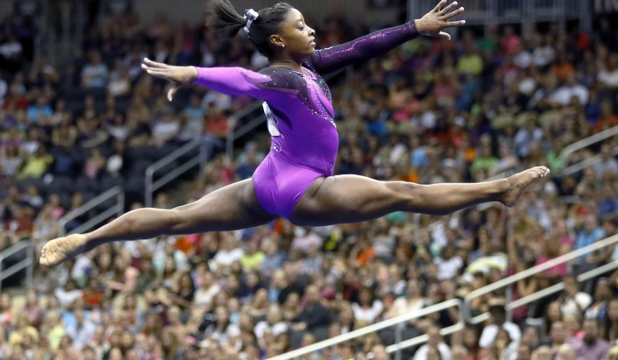 Simone Biles performs in the floor exercise portion of the competition the gymnastics U.S. Championships, Saturday, Aug. 23, 2014, in Pittsburgh. Biles captured her second straight U.S. women's gymnastics national title on Saturday night. (AP Photo/Keith Srakocic)