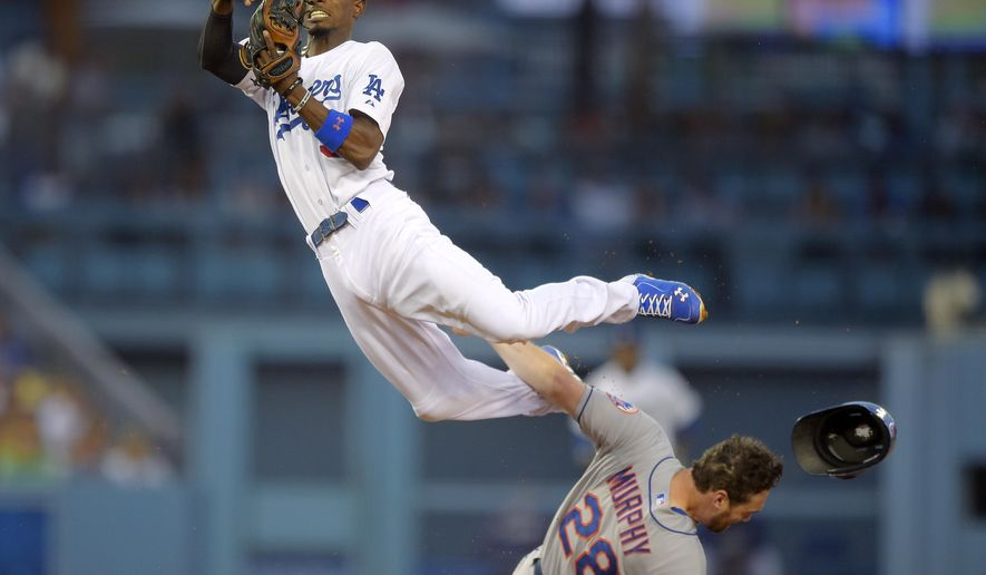 New York Mets' Daniel Murphy, below, is forced out at second as Los Angeles Dodgers second baseman Dee Gordon throws out David Wright at first during the fifth inning of a baseball game, Saturday, Aug. 23, 2014, in Los Angeles. (AP Photo/Mark J. Terrill)