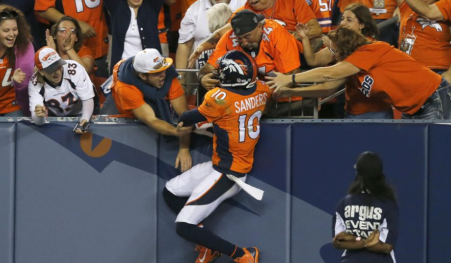 Denver Broncos wide receiver Emmanuel Sanders (10) celebrates his touchdown against the Houston Texans during the first half of an NFL preseason football game, Saturday, Aug. 23, 2014, in Denver. (AP Photo/Jack Dempsey)