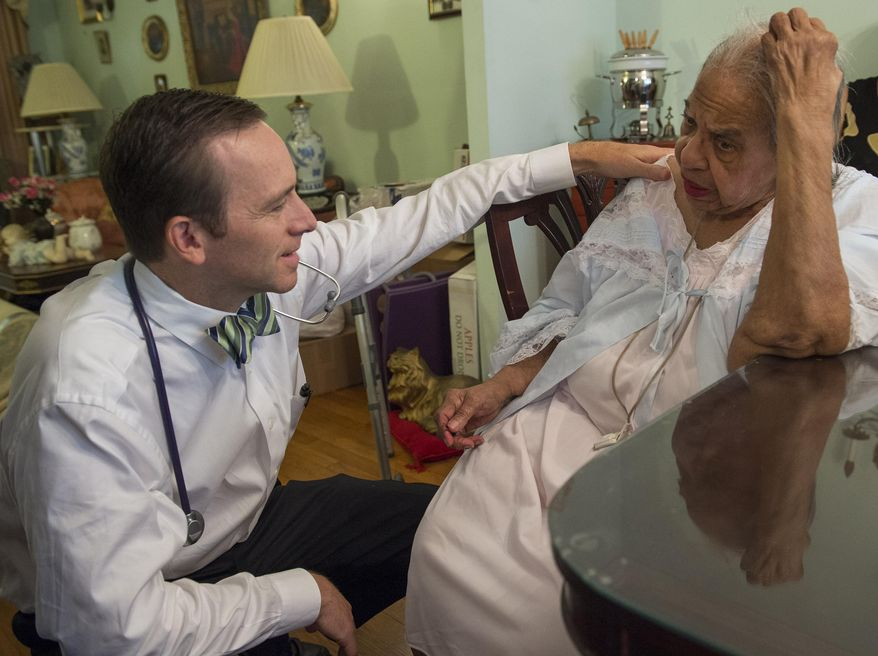 Dr. Eric De Jonge of Washington Hospital Center conducts a Medicare house call at the home of patient Beatrice Adams, in Washington. (AP Photo/Molly Riley)