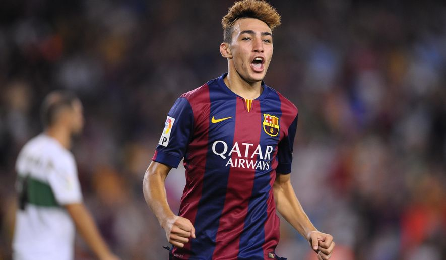 FC Barcelona's Munir reacts after scoring against Elche during a Spanish La Liga soccer match at the Camp Nou stadium in Barcelona, Spain, Sunday, Aug. 24, 2014. (AP Photo/Manu Fernandez)
