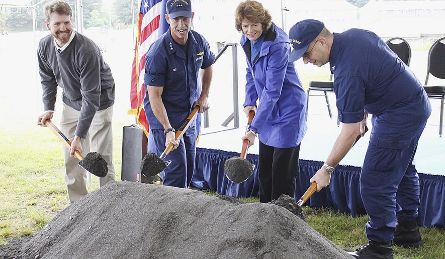 ADVANCE FOR USE MONDAY, AUG. 25 - This Aug. 14, 2014 photo shows from left, housing project manager Lars Wagner, Vice Admiral Charles Ray, commander of the Coast Guard Pacific Area, U.S. Sen. Lisa Murkowski and Capt. Jeffrey Westling, commander of Coast Guard Base Kodiak, scooping up gravel at the groundbreaking ceremony for a new Coast Guard Base Kodiak housing facility in Kodiak, Alaska. The housing facility is expected to be completed in 2016. (AP Photo/Kodiak Daily Mirror, Julie Herrmann)