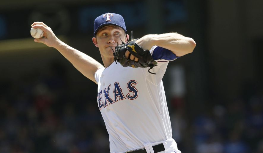 Texas Rangers starting pitcher Scott Baker throws during the first inning of a baseball game against the Kansas City Royals, Sunday, Aug. 24, 2014, in Arlington, Texas. (AP Photo/LM Otero)