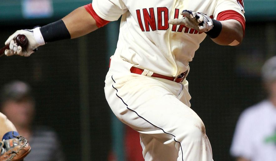 Cleveland Indians' Jose Ramirez watches his single that drove in the winning run in the ninth inning of a baseball game against the Houston Astros on Saturday, Aug. 23, 2014, in Cleveland. The Indians won 3-2. (AP Photo/Aaron Josefczyk)