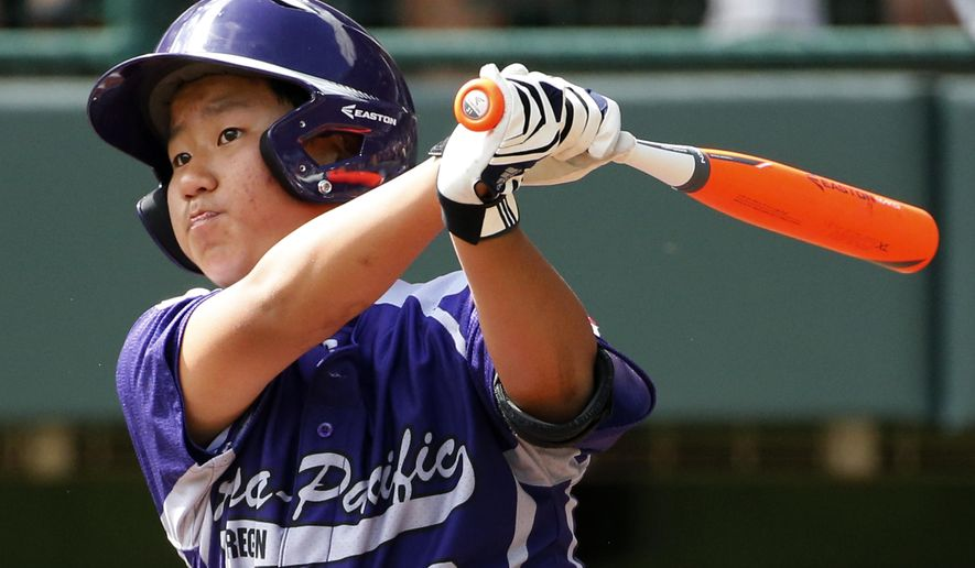 South Korea's Jae Yeong Hwang (18) drives in a run with a double off Chicago's Brandon Green in the first inning of the Little League World Series championship baseball game in South Williamsport, Pa., Sunday, Aug. 24, 2014. (AP Photo/Gene J. Puskar)