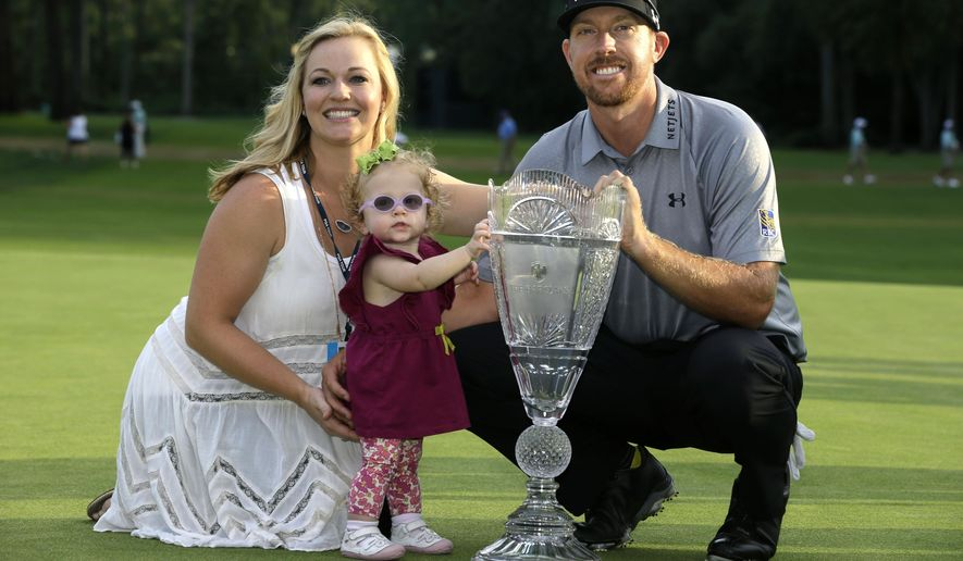 Hunter Mahan poses with his wife, Kandi and daughter Zoe and the trophy after winning the The Barclays golf tournament Sunday, Aug. 24, 2014, in Paramus, N.J. Mahan won the tournament with a 14 under-par 270.   (AP Photo/Mel Evans)