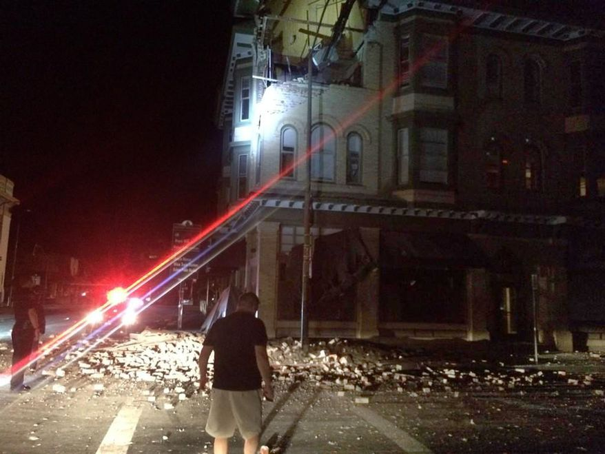 This photo provided by Lyall Davenport shows damage to a building in Napa, Calif. early Sunday, Aug. 24, 2014. Officials say an earthquake with a preliminary magnitude of 6.0 has been reported in California's northern San Francisco Bay area. (AP Photo/Lyall Davenport)