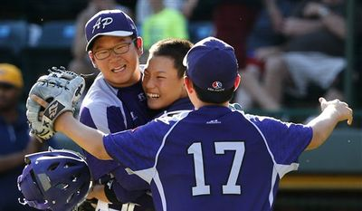 South Korea's Hae Chan Choi, left, celebrates with catcher Sang Hoon Han, center, and Shane Jaemin Kim (17) after getting the final out of a 8-4 win in the Little League World Series championship baseball game against Chicago in South Williamsport, Pa., Sunday, Aug. 24, 2014. (AP Photo/Gene J. Puskar)