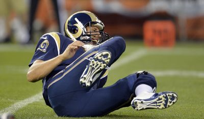 St. Louis Rams quarterback Sam Bradford grimaces after being hit by Cleveland Browns defensive lineman Armonty Bryant in the first quarter of a preseason NFL football game Saturday, Aug. 23, 2014, in Cleveland. (AP Photo/David Richard)