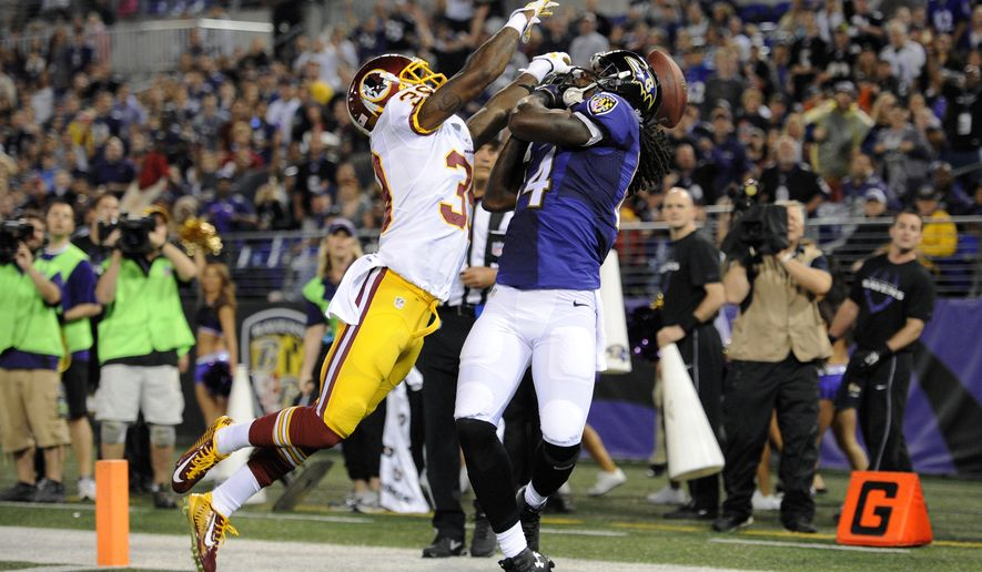 Washington Redskins free safety David Amerson, left, breaks up a pass attempt to Baltimore Ravens wide receiver Marlon Brown in the end zone in the first half of an NFL preseason football game, Saturday, Aug. 23, 2014, in Baltimore. (AP Photo/Nick Wass)