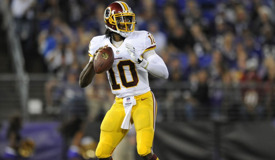 Washington Redskins quarterback Robert Griffin III looks for a receiver in the first half of an NFL preseason football game against the Baltimore Ravens, Saturday, Aug. 23, 2014, in Baltimore. (AP Photo/Gail Burton)