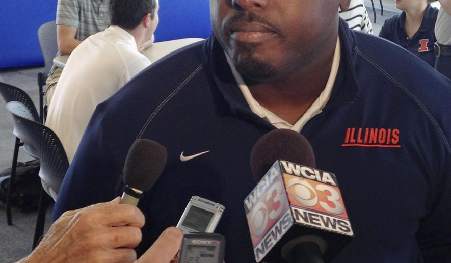 Illinois defensive coordinator Tim Banks talks to reporters at Memorial Stadium in Champaign, Ill., on Monday, Aug. 25, 2014. Banks believes the Illini defense will be significantly better this fall after being among the Big Ten's worst in 2013. (AP Photo/David Mercer)