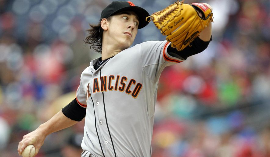 San Francisco Giants pitcher Tim Lincecum throws the ball during the first inning of a baseball game against the Washington Nationals, Saturday, Aug. 23, 2014, in Washington. The Nationals won 6-2. (AP Photo/Luis M. Alvarez)