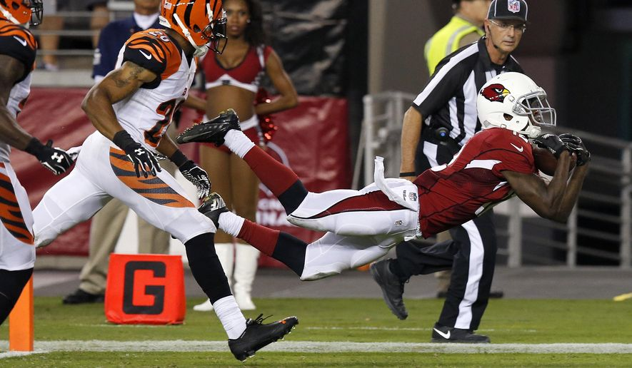 Arizona Cardinals wide receiver John Brown (12) makes a diving touchdown catch as Cincinnati Bengals defensive back R.J. Stanford (28) defends during the second half of an NFL preseason football game, Sunday, Aug. 24, 2014, in Glendale, Ariz. (AP Photo/Ross D. Franklin)