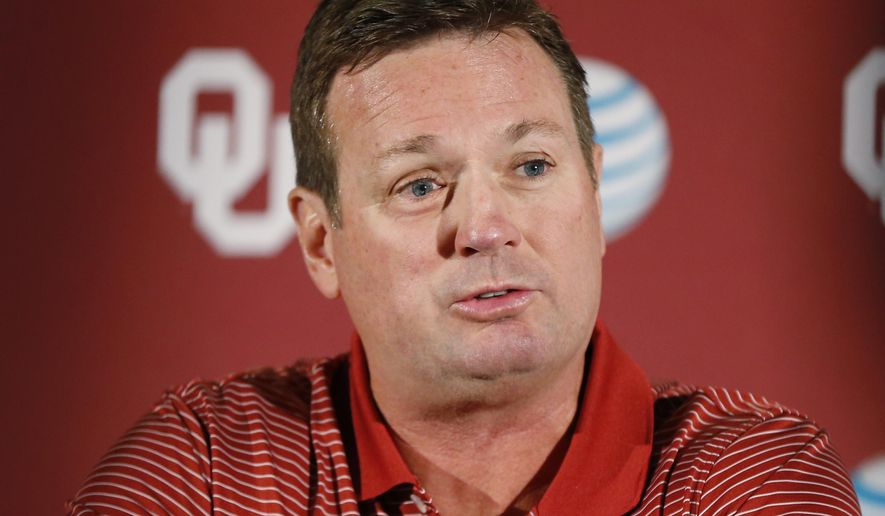Oklahoma head coach Bob Stoops answers a question during a news conference in Norman, Okla., Monday, Aug. 25, 2014. Some uncertainties have cleared up as No. 4 Oklahoma prepares to open the season Saturday against Louisiana Tech. (AP Photo/Sue Ogrocki)