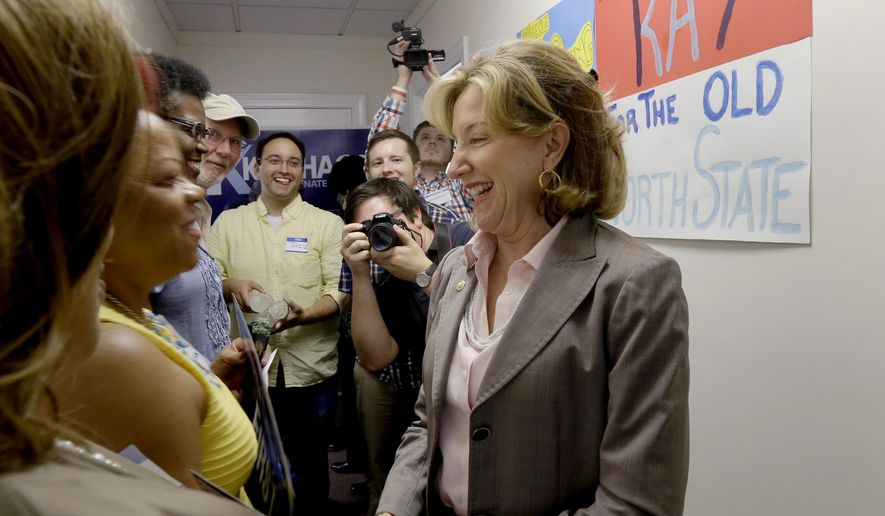 Sen. Kay Hagan, D-N.C., greets supporters during a visit to a campaign field office in Goldsboro, N.C., Monday, Aug. 25, 2014. (AP Photo/Gerry Broome)