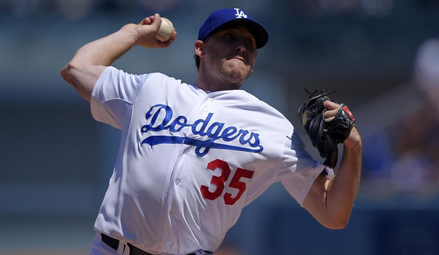 Los Angeles Dodgers starting pitcher Kevin Correia throws to the plate during the first inning of a baseball game against the New York Mets, Sunday, Aug. 24, 2014, in Los Angeles. (AP Photo/Mark J. Terrill)