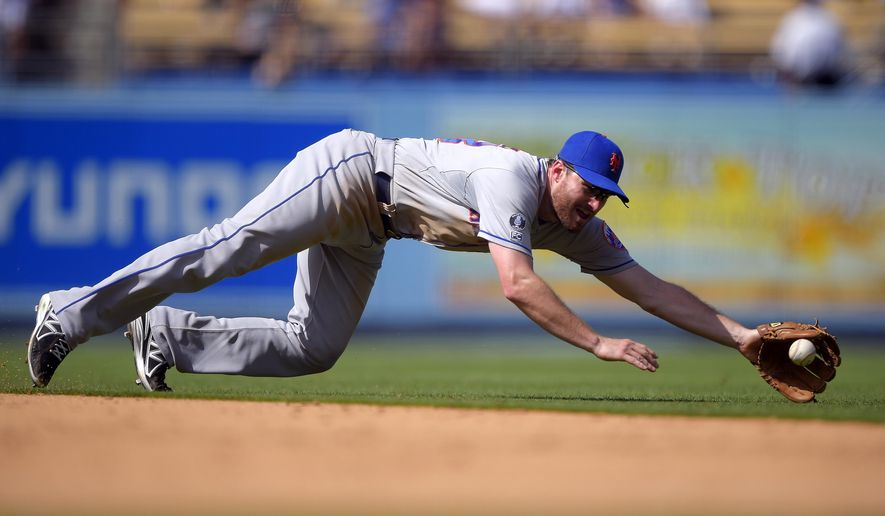 New York Mets second baseman Daniel Murphy can't reach a ball hit for a single by Los Angeles Dodgers' Andre Ethier during the seventh inning of a baseball game, Sunday, Aug. 24, 2014, in Los Angeles. (AP Photo/Mark J. Terrill)