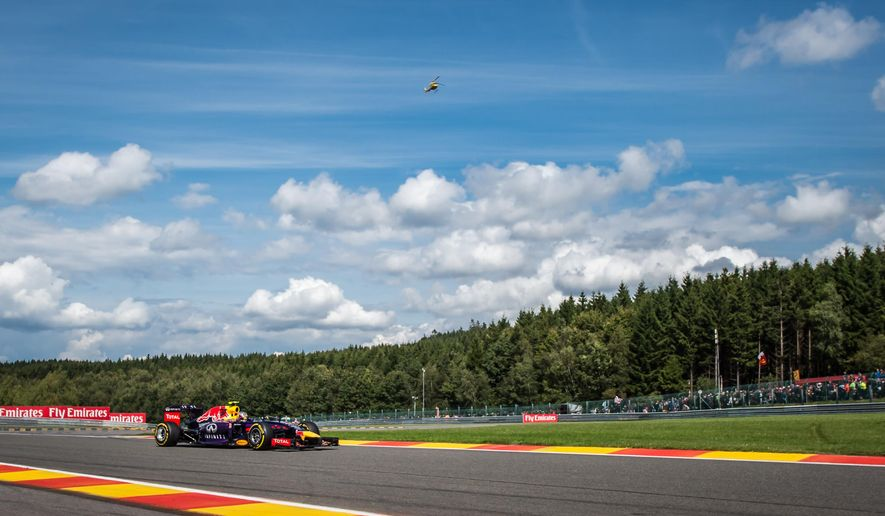 Red Bull driver Daniel Ricciardo of Australia steers his car during the Belgian Formula One Grand Prix in Spa-Francorchamps, Belgium, Sunday, Aug. 24, 2014. Red Bull driver Daniel Ricciardo of Australia won the race, Mercedes driver Nico Rosberg of Germany finished second and Williams driver Valtteri Bottas of Finland third. (AP Photo/Geert Vanden Wijngaert)
