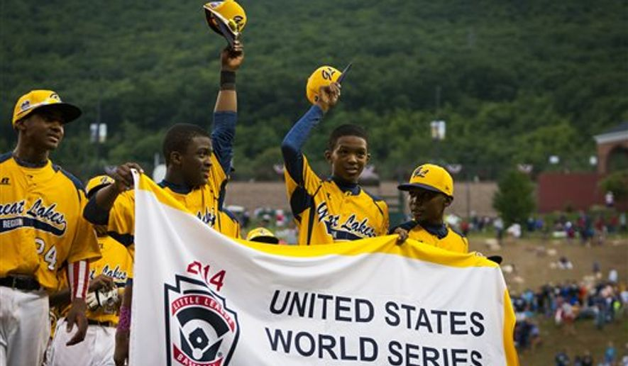 Chicago players acknowledge the crowd after the U.S. final of the Little League World Series, Saturday, Aug. 23, 2014, in South Williamsport, Pa. Chicago defeated Las Vegas 7-5. (AP Photo/PennLive.com, Elizabeth Frantz)