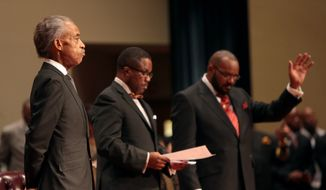 The Rev. Al Sharpton, left, attends the funeral services for 18-year-old Michael Brown on Monday, Aug. 25, 2014, at Friendly Temple Missionary Baptist Church in St. Louis. Hundreds of people gathered to say goodbye to Brown, who was shot and killed by a Ferguson, Mo., police officer on Aug. 9. (AP Photo/St. Louis Post Dispatch, Robert Cohen, Pool)