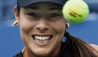 Ana Ivanovic, of Serbia, returns a shot against Alison Riske, of the United States, during the opening round of the 2014 U.S. Open tennis tournament, Tuesday, Aug. 26, 2014, in New York. (AP Photo/Kathy Willens)