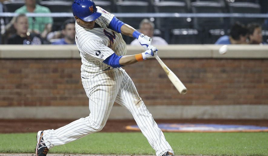CORRECTS TO TWO-RUN HOME RUN - New York Mets' Juan Lagares hits a two-run home run in the fourth inning of a baseball game against the Atlanta Braves on Tuesday, Aug. 26, 2014, in New York. (AP Photo/John Minchillo)