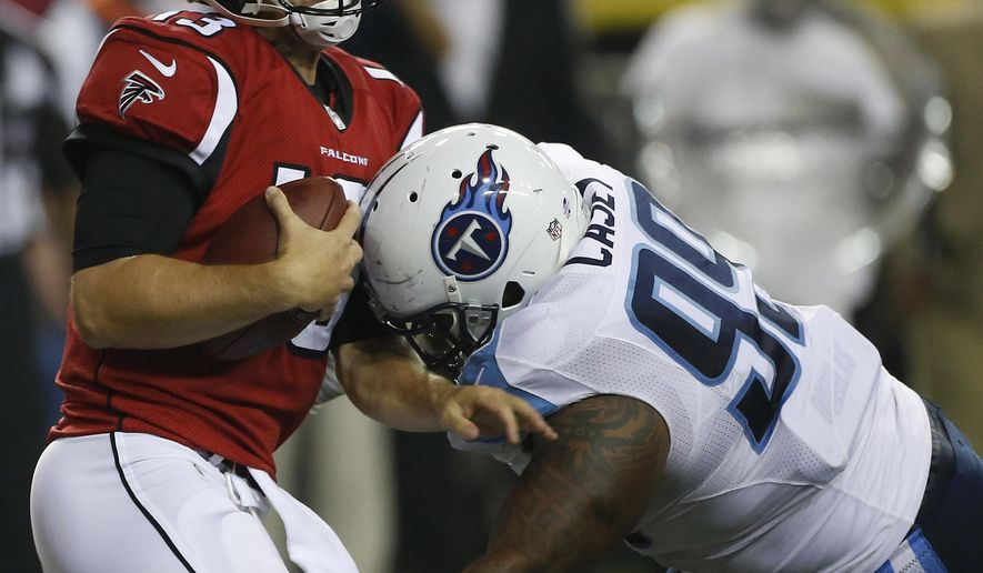 Atlanta Falcons quarterback T.J. Yates (13) is hit behind the line of scrimmage by Tennessee Titans defensive tackle Jurrell Casey (99) during the second half of an NFL preseason football game, Saturday, Aug. 23, 2014, in Atlanta. (AP Photo/John Bazemore)