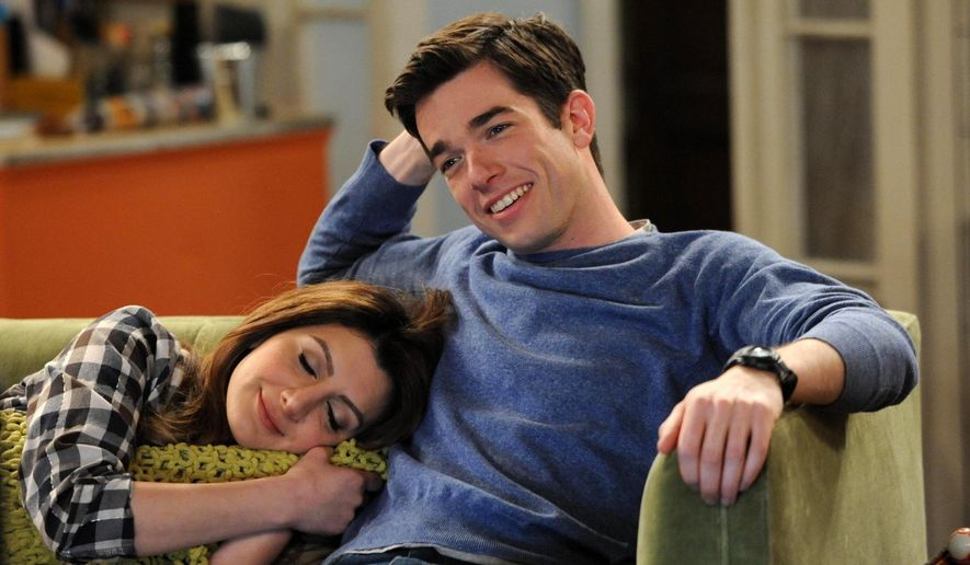 """This image released by Fox shows Nasim Pedrad, left, and John Mulaney in a scene from the comedy, """"Mulaney,"""" premiering Oct. 5. (AP Photo/Fox, Ray Mickshaw)"""