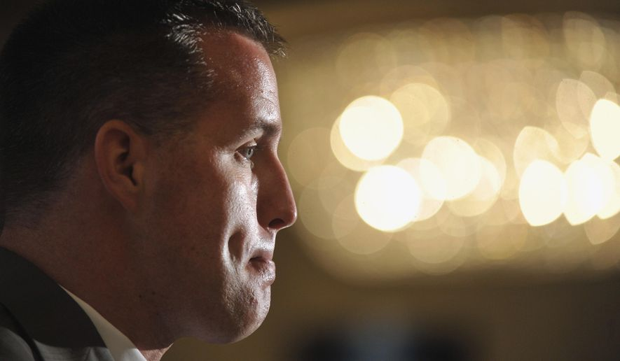 FILE - In this July 28, 2014, file photo, Northwestern head coach Pat Fitzgerald ponders a reporters' question during the Big Ten football media days in Chicago. The offseason debate over whether college players should have the right to unionize are fading as Northwestern gets ready to host California in their season opener on Aug. 30. (AP Photo/Paul Beaty, File)