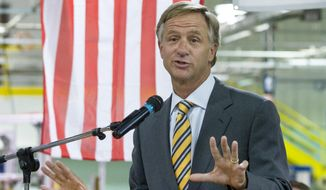 "Gov. Bill Haslam speaks at an economic development announcement in Cookville, Tenn., on Monday, Aug. 25, 2014. The Republican governor shrugged off a letter from state Rep. Rick Womick who had called it ""treasonous"" for a political action committee run by Haslam supporters to target GOP lawmakers who opposed the adminstration on Common Core education standards. (AP Photo/Erik Schelzig)"
