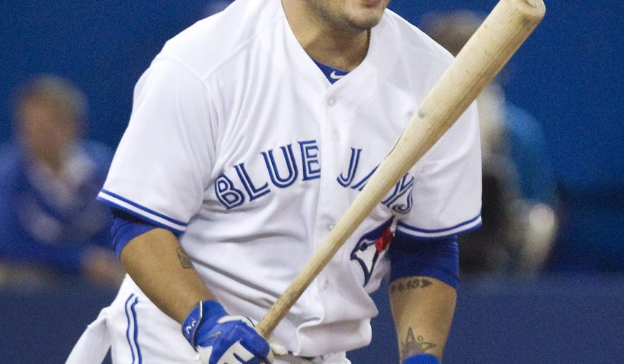 Toronto Blue Jays' Dioner Navarro reacts after flying out against the Boston Red Sox during the ninth inning of a baseball game Monday, Aug. 25, 2014, in Toronto. Boston won 4-3. (AP Photo/The Canadian Press, Fred Thornhill)