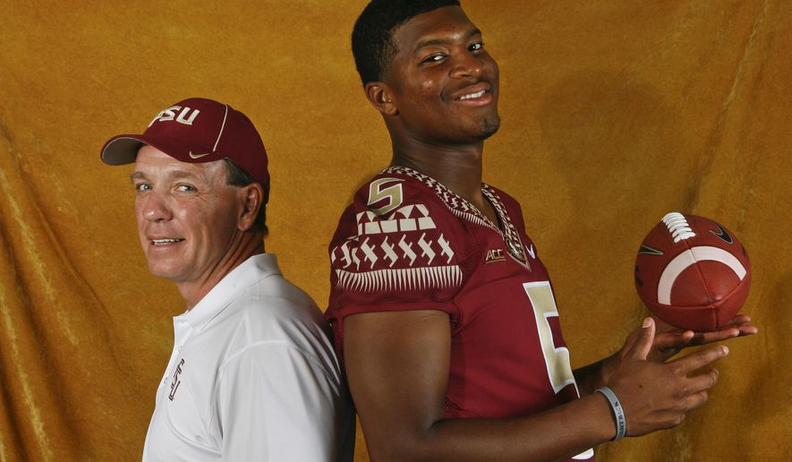 FILE - In this Aug. 10, 2014, file photo, Florida State head coach Jimbo Fisher, left, and quarterback Jameis Winston (5) pose for a photo during their NCAA college football media day in Tallahassee, Fla. Fisher may be the pre-eminent quarterback coach in college football. He has had eight quarterbacks drafted to the NFL since 2001, works with reigning Heisman winner Jamies Winston and two of his former Seminole disciples are expected to start for other major college programs this year. (AP Photo/Phil Sears, File)