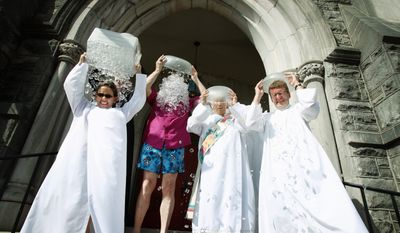 Clergy members of the Episcopal Diocese of West Tennessee take part in the Ice Bucket Challenge on the steps of St. Mary's Cathedral. (ASSOCIATED PRESS PHOTOGRAPHS)