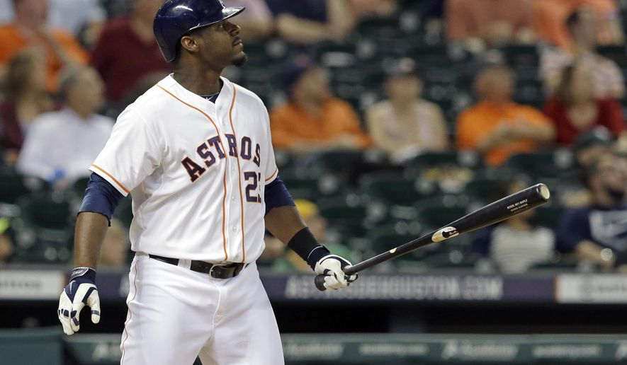 Houston Astros' Chris Carter watches the ball go over the wall for a go-ahead three-run home run against the Oakland Athletics in the eighth inning of a baseball game Tuesday, Aug. 26, 2014, in Houston. The Astros won 4-2. (AP Photo/Pat Sullivan)