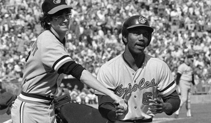 FILE - In this Oct. 5, 1974, photo, Baltimore Orioles' Paul Blair is greeted at the plate after a home run in the opening game against the Oakland Athletics in the American League baseball playoffs in Oakland, Calif. Blair, the eight-time Gold Glove center fielder who helped the Orioles win World Series titles in 1966 and 1970, died Thursday night, Dec. 26, 2013, at Sinai Hospital of Baltimore. (AP Photo)