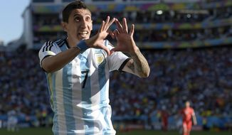 Argentina's Angel di Maria celebrates after scoring his side's only and winning goal in extra time during the World Cup round of 16 soccer match between Argentina and Switzerland at the Itaquerao Stadium in Sao Paulo, Brazil, Tuesday, July 1, 2014. Argentina defeated Switzerland 1-0 to move on to the quarterfinals. (AP Photo/Manu Fernandez)