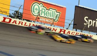 FILE - In this April 12, 2014, file photo, drivers race during a NASCAR Sprint Cup series auto race at Darlington Raceway in Darlington, S.C. Darlington Raceway is quiet this Mother's Day weekend after nearly a decade as NASCAR's focal point for honoring mom. But raceway president Chip Wile was pleased with the track's recently run Southern 500 last month and is excited about what's ahead for the sport's oldest superspeedway. (AP Photo/Mike McCarn, File)