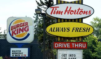 Canada's iconic coffee chain, Tim Hortons, and Miami-based Burger King say they will join forces but will operate as independent brands to form the world's third-largest quick-service restaurant company. (AP Photo/The Canadian Press, Sean Kilpatrick)