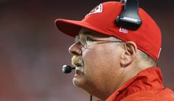 Kansas City Chiefs head coach Andy Reid looks at the scoreboard during the second half of an NFL preseason football game against the Minnesota Vikings in Kansas City, Mo., Saturday, Aug. 23, 2014. (AP Photo/Ed Zurga)