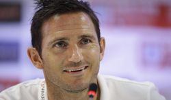 FILE - In this Tuesday, June 17,  2014 file photo England national soccer team player Frank Lampard answers a question from a journalist during a press conference, at the Urca military base in Rio de Janeiro, Brazil. Lampard has retired from England's national team ahead of qualifying for the 2016 European Championship, it was reported on Tuesday, Aug. 26, 2014. Since making his England debut in 1999, the 36-year-old Lampard has scored 29 goals in 106 appearances, with his last appearance coming at the World Cup in June. (AP Photo/Matt Dunham, File)