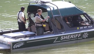 """Rescue personnel search Henry Hagg Lake, a reservoir in Gaston, Ore., west of Portland, Tuesday, Aug. 26, 2014, for family members of a child who apparently drowned Monday at the lake. """"Deputies fear there may be additional drowning victims,"""" the sheriff's office said in a press release. (AP Photo/The Oregonian, Benjamin Brink)  MAGS OUT; TV OUT; LOCAL TELEVISION OUT; LOCAL INTERNET OUT; THE MERCURY OUT; WILLAMETTE WEEK OUT; PAMPLIN MEDIA GROUP OUT"""