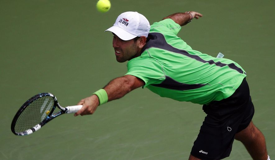 Wayne Odesnik, of the United States, returns a shot against Kei Nishikori, of Japan, during the first round of the 2014 U.S. Open tennis tournament, Tuesday, Aug. 26, 2014, in New York. (AP Photo/Matt Rourke)