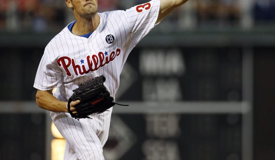 Philadelphia Phillies' Cole Hamels pitches during the third inning of a baseball game against the Washington Nationals, Tuesday, Aug. 26, 2014, in Philadelphia. (AP Photo/Matt Slocum)