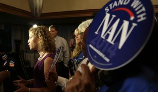 Democratic National Committee Chairwoman Debbie Wasserman Schultz, left, a Florida congresswoman, speaks to the media at a gathering for supporters of Democratic gubernatorial candidate Nan Rich, Tuesday, Aug. 26, 2014, in Weston, Fla. Rich later conceded defeat to her opponent Charlie Crist in the primary election for the democratic nomination for Florida Governor. (AP Photo/Lynne Sladky)